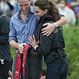 In July 2011, William wrapped Kate in a hug after the two competed in a dragon boat race during their trip to Canada.