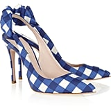We love the thought of pairing these with cuffed boyfriend jeans and a white blazer for a cool, casual work look.  Miu Miu Gingham Taffeta Slingbacks ($595)