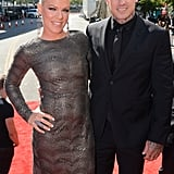 Pink and Carey Hart had their arms around each other when they arrived.
