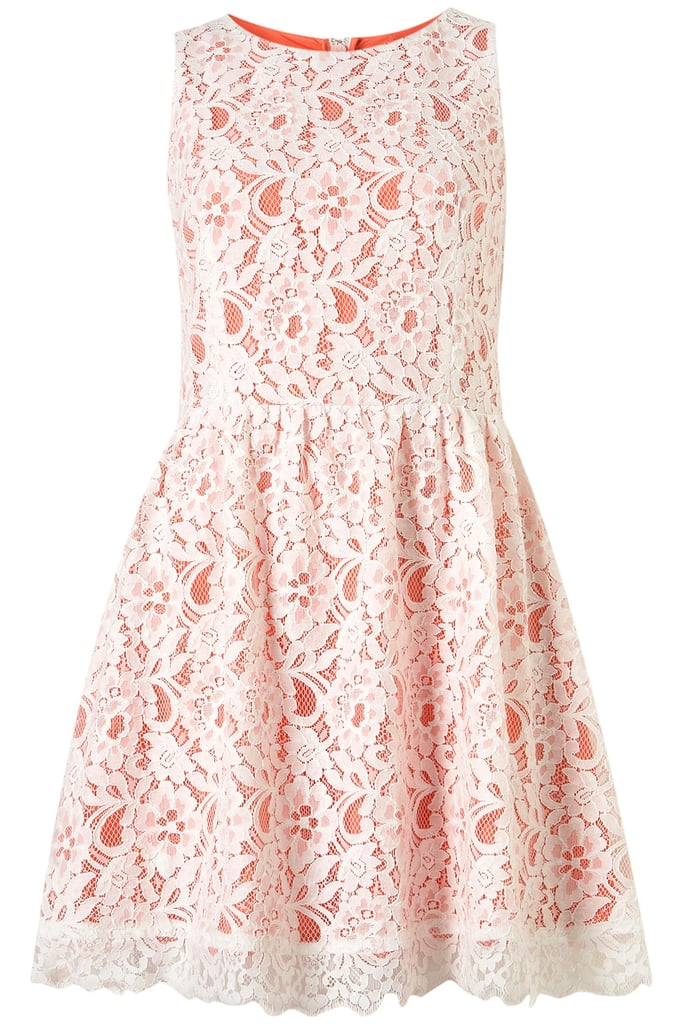 We love how the bright underlay makes this white lace pop.  Topshop Sleeveless Lace Dress ($96)