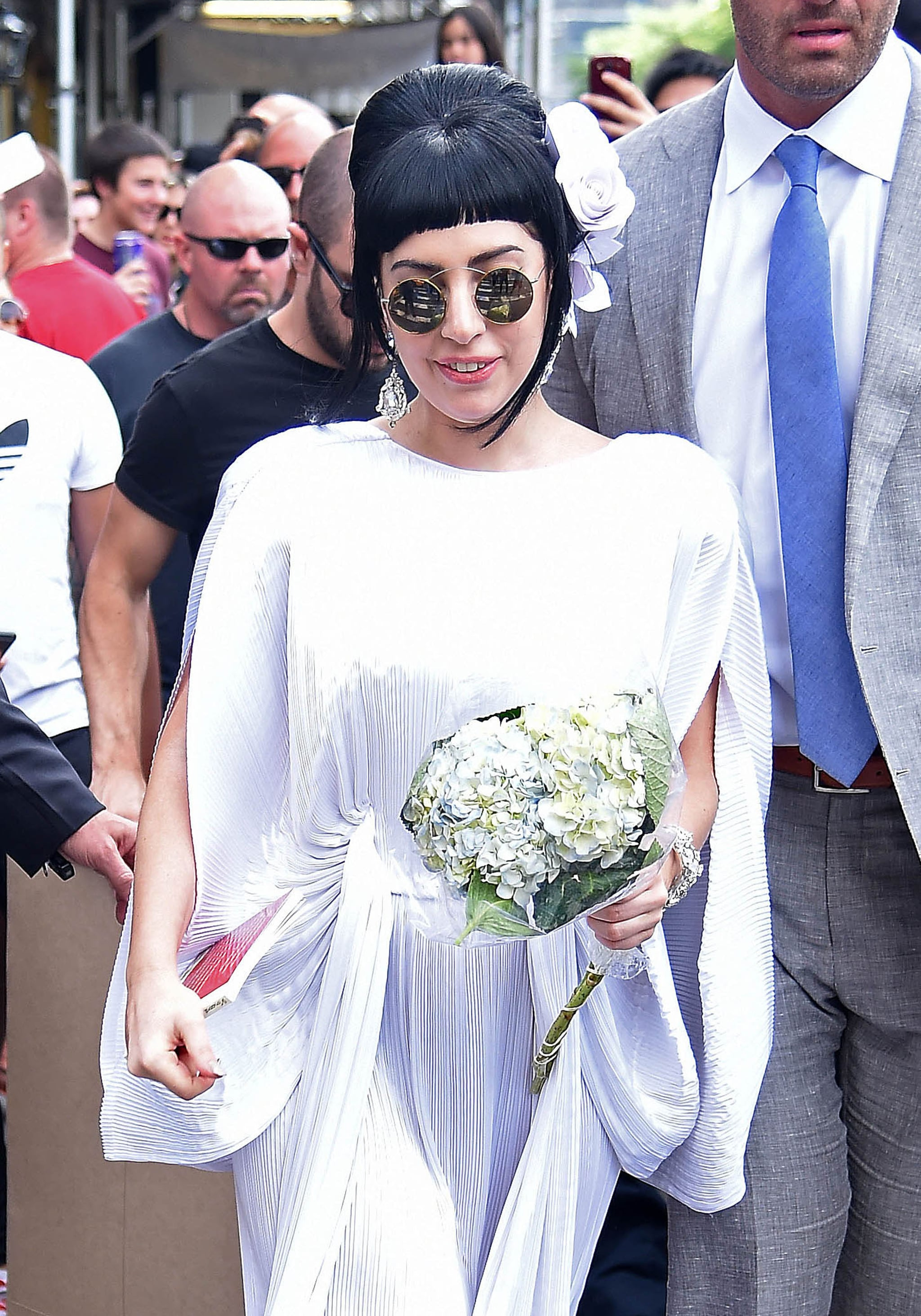 Lady Gaga stepped out in wedding white in NYC on Friday.