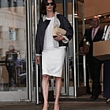 On day two, the supermodel opted for a lighter look: a white lace top with a white pencil skirt, finished off with another pair of round shades, a Chanel bag, and nude pumps.