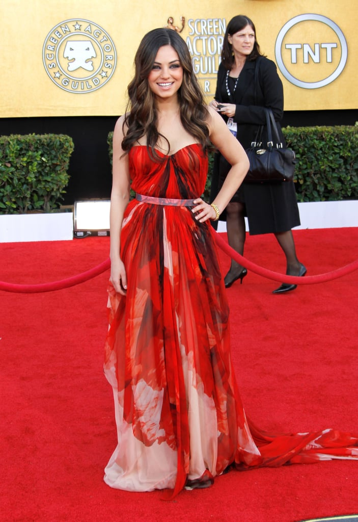 Mila Kunis chose a printed red Alexander McQueen gown for the SAGs in LA  last night. She complemented the bold dress with a Cartier cuff and soft curls — what do you think of her look? Mila's up for best supporting actress for her role in Black Swan after being nominated for multiple awards this season. Make sure to vote on all of Fab and Bella's live Love It or Leave It polls now!