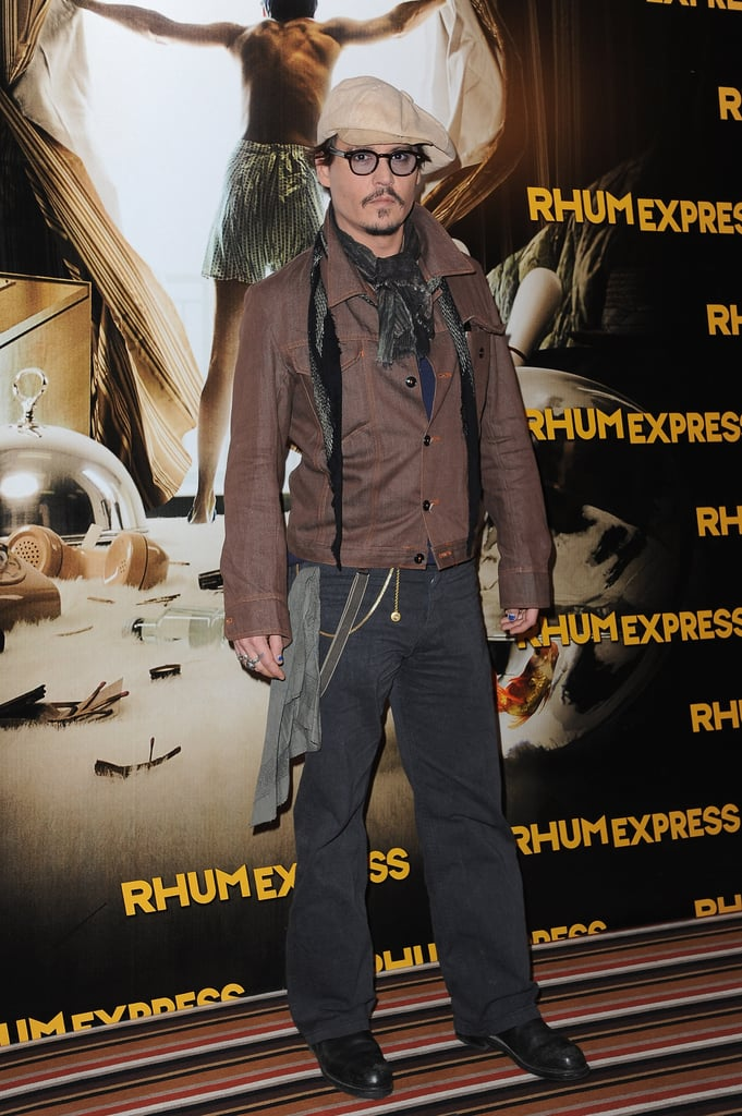 Johnny Depp arrived in his trademark glasses and accessorized with a newsboy  cap. c5434e30ce3