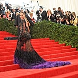 Wearing a black and purple feathered Givenchy gown to the Met Gala in 2012.