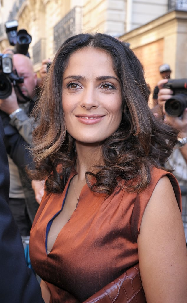 Salma Hayek smiled for photographers.