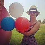 Emmy Rossum sported a cute, colorful dress and posed with patriotic balloons. Source: Instagram user emmyrossum