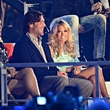 Mike Fisher and Carrie Underwood laughed in the audience.