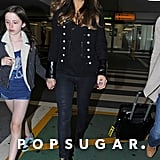Kate added intrigue to her monochrome look with a leather-cuffed military jacket while strolling through Heathrow Airport with her daughter, Lily, in June 2010.