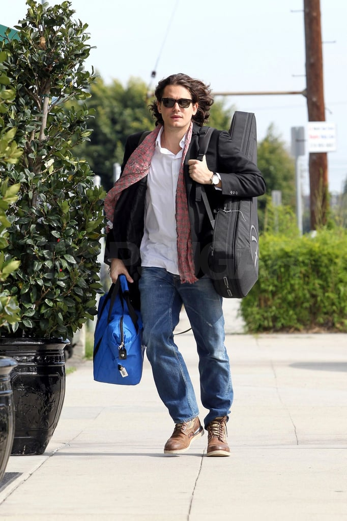John Mayer carried his own bags and guitar yesterday while arriving at a private recording studio in Santa Monica. The singer made a rather dapper arrival to LA last week and has since adapted to the California casual vibe. In his spare time, John's made a return to blogging and recently hinted that he may start writing new songs, though he hasn't confirmed any plans for his next album. He has, however, nailed down details for his charitable May 16 performance. He'll be playing a private show for 100 fans who ponied up $250 a ticket to attend with all proceeds benefiting the We Are Family Foundation and NCIRE and Fisher House organizations. John's been a longtime supporter of veteran groups, and this is just his latest event organized to benefit a philanthropic cause.