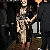 Miranda Kerr struck a model pose in a sequin-and-lace Dolce & Gabbana creation at a W Magazine party in LA. She accessorized her gleaming party dress with a mirrored clutch and bow-detail sandals.