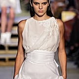 Kendall walked the runway at Givenchy wearing a white top with a waist wrap and lace detail.