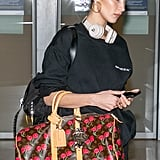 A standard size hoop earring is so classic, you know you'll be able to wear it throughout an entire vacation. So that they don't get mixed up in your luggage, just wear them on the plane, like Bella Hadid.