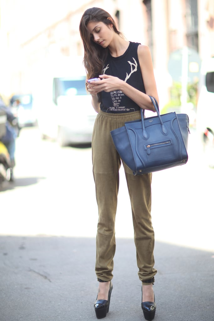 A pair of easy sweatpants got a luxe finish with a Celine bag and sky-high platforms. Source: Greg Kessler