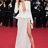 In 2015, Petra Nemcová wore a white Zuhair Murad peplum jacket and skirt combo that was equal parts sexy and chic.