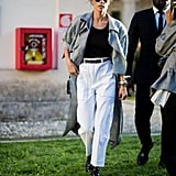 Alessandra Ambrosio Wore a Black Tank Top Tucked Into High-Waisted Trousers