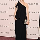 Kirsten Dunst channeled Old Hollywood glamour in a black one-shouldered Chloé gown paired with a beaded clutch.