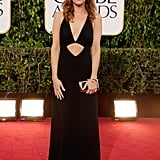 Kristen Wiig wore a black cutout Michael Kors gown.
