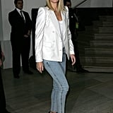 Here Gwyneth paired a white double-breast blazer with '80s-style skinny jeans and pumps. Get her look below.
