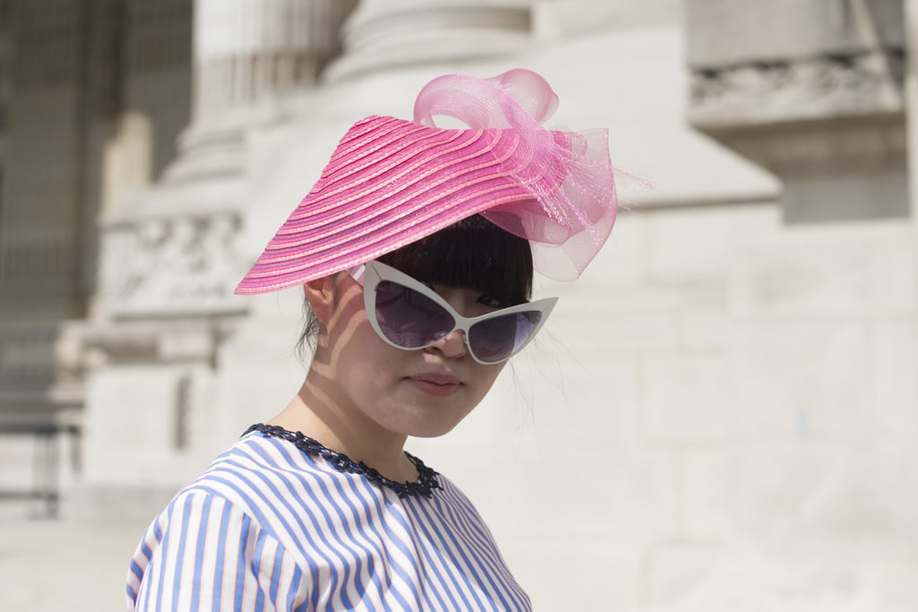 A bubblegum pink headpiece and cat-eye shades ensured that this showgoer got noticed.