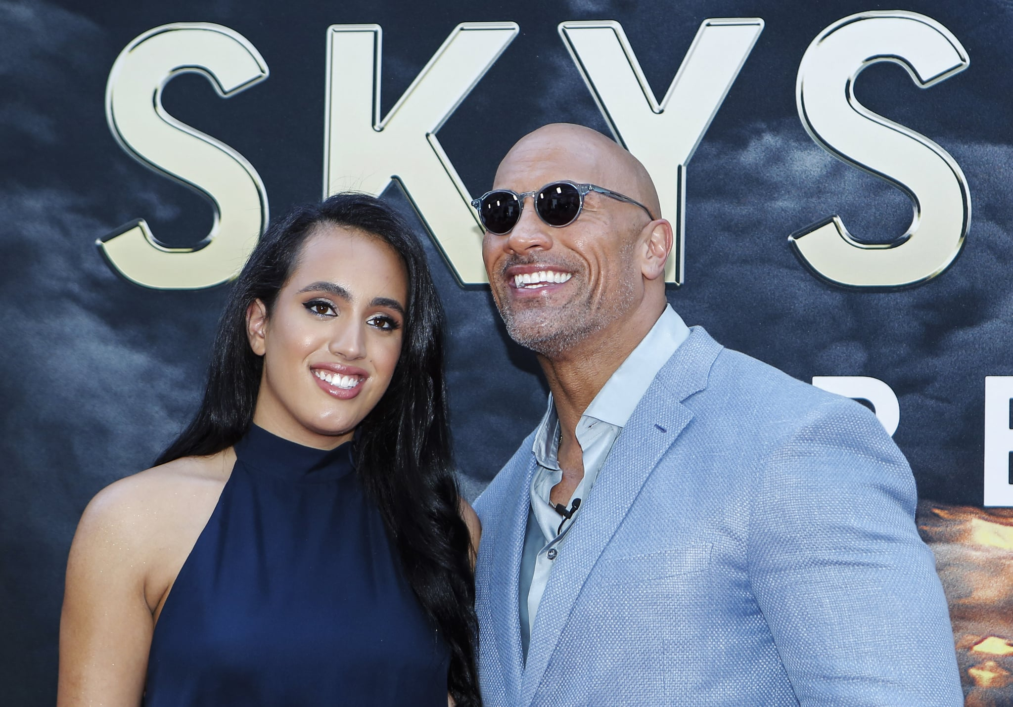 Actor Dwayne Johnson and his daughter Simone Alexandra Johnson attend the premiere of 'Skyscraper' on July 10, 2018 in New York City. (Photo by KENA BETANCUR / AFP)        (Photo credit should read KENA BETANCUR/AFP/Getty Images)