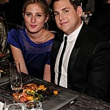 Jonah Hill snuggles close to his date Ali Hoffman.