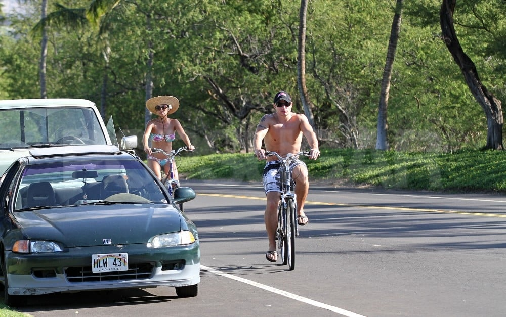 Nick Lachey and Vanessa Minnillo went for bike rides in their bathing suits.