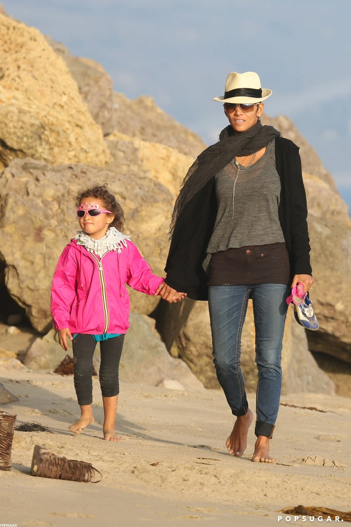 Halle Berry and her daughter, Nahla, enjoyed an afternoon of fun at a beach in Malibu on Sunday. Halle, who recently reached a custody agreement over Nahla with ex-boyfriend Gabriel Aubry, played and laughed with her daughter as they strolled barefoot in the sand. Nahla, in a K-Way jacket, even danced around her mom before dramatically collapsing on the sand for a short break. Although she was at the beach, Halle, who is currently in running for the title of hottest bikini body of the year, opted to skip a two-piece in favor of more weather-appropriate casual clothes.
