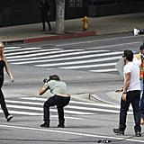 Gwyneth Paltrow walked in the middle of a street.