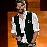 Liam Hemsworth posed on stage during the award show.