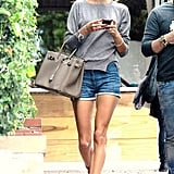 Cutoff-chic Alessandra Ambrosio accessorized her pair with a Birkin, a neutral knit, and nude sandals to give her supermodel stems even more length.