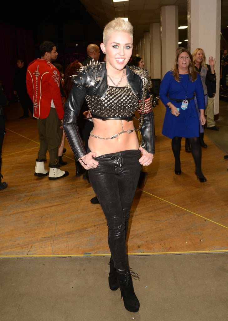 Diva is spelled M-i-l-e-y. The star posed backstage in a studded and spiked black leather ensemble, complete with a handcuff body chain and suede platform boots for VH1 Divas event in 2012.