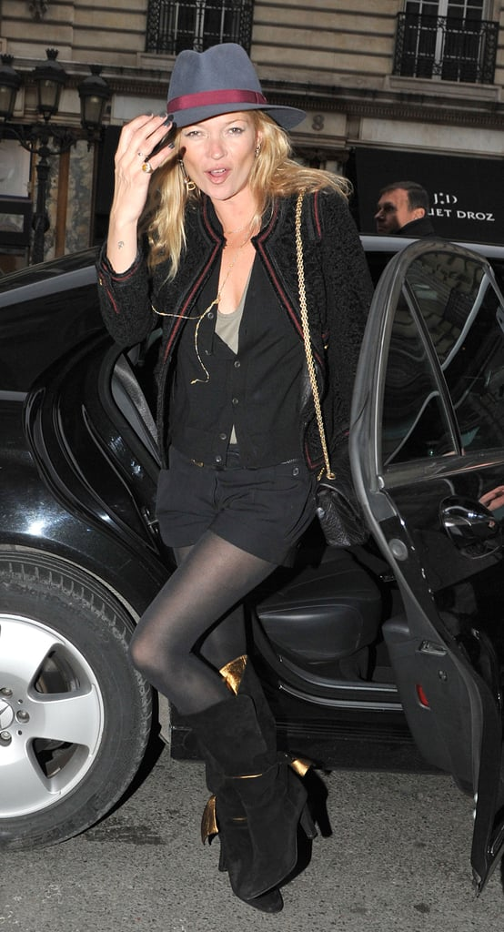 Kate Moss was in high spirits as she took to the streets of Paris yesterday to do some jewellery shopping. Earlier this week she watched the Etam lingerie show alongside Alexa Chung, and watched her man Jamie Hince perform there too with his band The Kills. Kate's been getting raunchy in a new music video which is not one of Jamie's, but she was all covered up in the cold city. North London residents should keep an eye out as Kate's reportedly just bought a place in Highgate.
