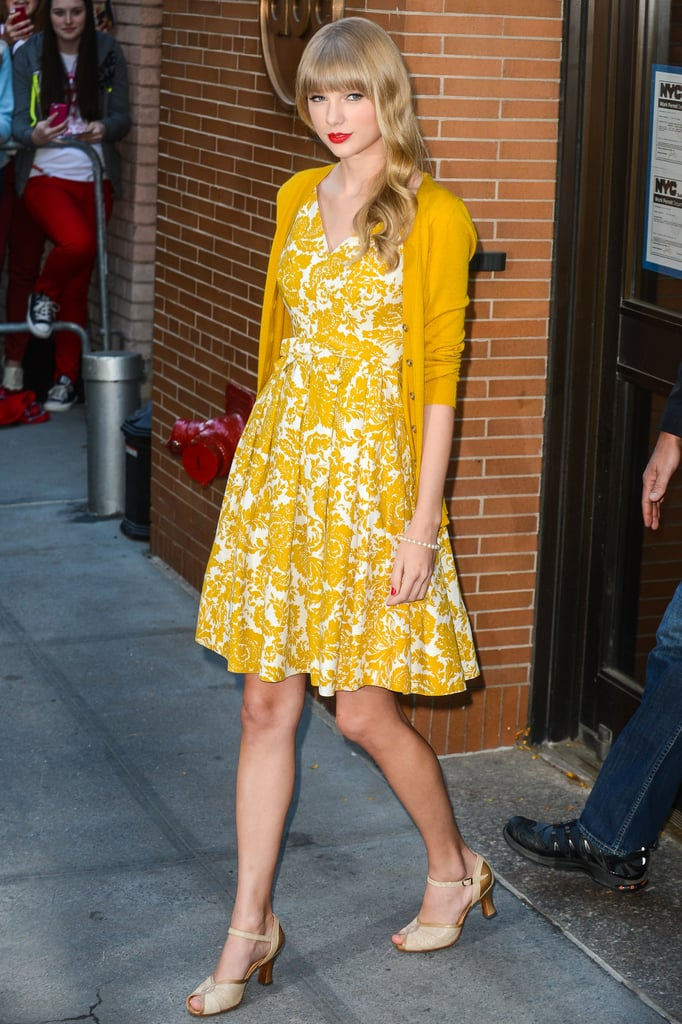 We love a matchy-matchy moment. Taylor styled her yellow floral dress with a vibrant marigold cardigan on top.