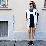 Aside from easy-to-walk-in embellished booties and a breezy dress, the final piece this outfit calls for is an oversize bomber, which completely changes up the look and helps veer toward the sporty side.