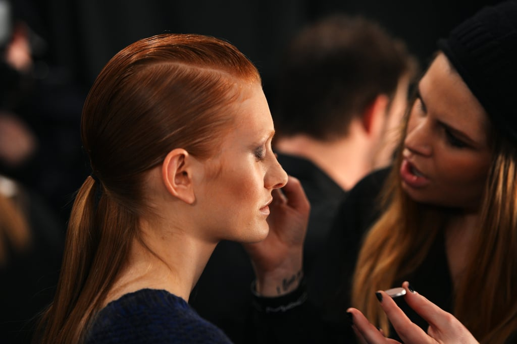 """We wanted a really high-shine, strong look because it's a trip to Mars, so it's a little bit sci-fi,"" explained lead hairstylist James Pecis. One of the looks was a futuristic version of the ponytail. First, hair was parted from temples to the nape to create a mohawk section or pompadour section. After slicking back the sides, a ponytail was fastened over the middle portion. Pecis used Bumble and Bumble Thickening Spray on dry hair to get maximum hold that would be easy to erase between models' shows."