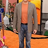 Rob Riggle was color coordinated with the carpet in a bright orange shirt.