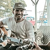 The guitar, that smile — it's almost too much.