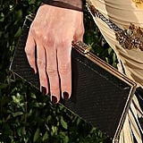 Kate Beckinsale finished her look with this sleek clutch.