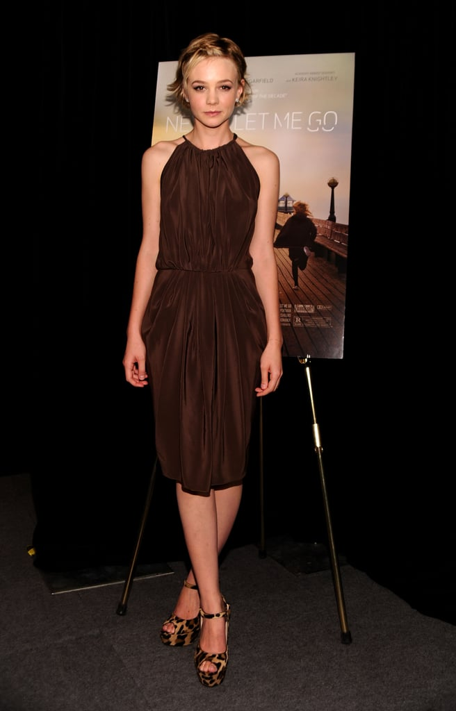 While promoting Never Let Me Go in Toranto, Carey Mulligan styled a chocolate crepe de chine Vionnet halter with leopard Prada maryjanes.