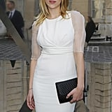 Scarlett Johansson posed for pictures outside of the Tod's Party for Paris Fashion Week.