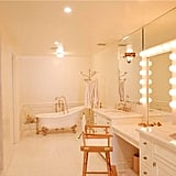 The marble-outfitted bathroom includes a luxe free-standing tub, large shower, and well-lit dressing area where Lauren can get ready for red carpet appearances.