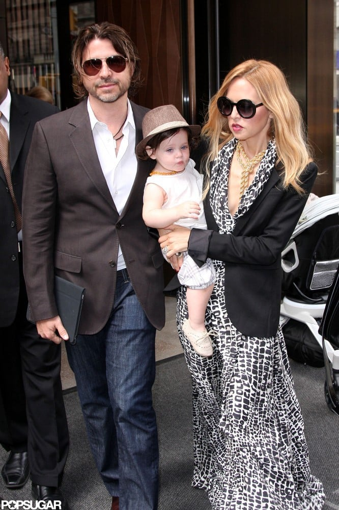 Rachel Zoe and Rodger Berman left the Trump SoHo hotel in NYC today with their son, Skyler. Skyler, decked out in a hat and beaded necklace, was on his mom's hip as they headed out. The family is spending a little time on the East Coast after Rachel, Rodger, and Skyler attended Saturday's Veuve Clicquot Polo Classic. Rachel and Rodger also went to Monday night's Council of Fashion Designers of America Awards.  We were on the red carpet at the CFDA Awards and grabbed a moment with Rachel before she headed inside. She told us she looked at the event as a chance to unwind and catch up with her fashionable friends. The night was work-free for Rachel following last month's more labor-intensive Met Gala, where she dressed model Karolina Kurkova in a custom-made gown of her design.