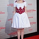 Emma Stone arrived at the LA premiere looking sweet in her Chanel dress, though she countered the girlie silhouette with a pair of high-impact Louboutins.