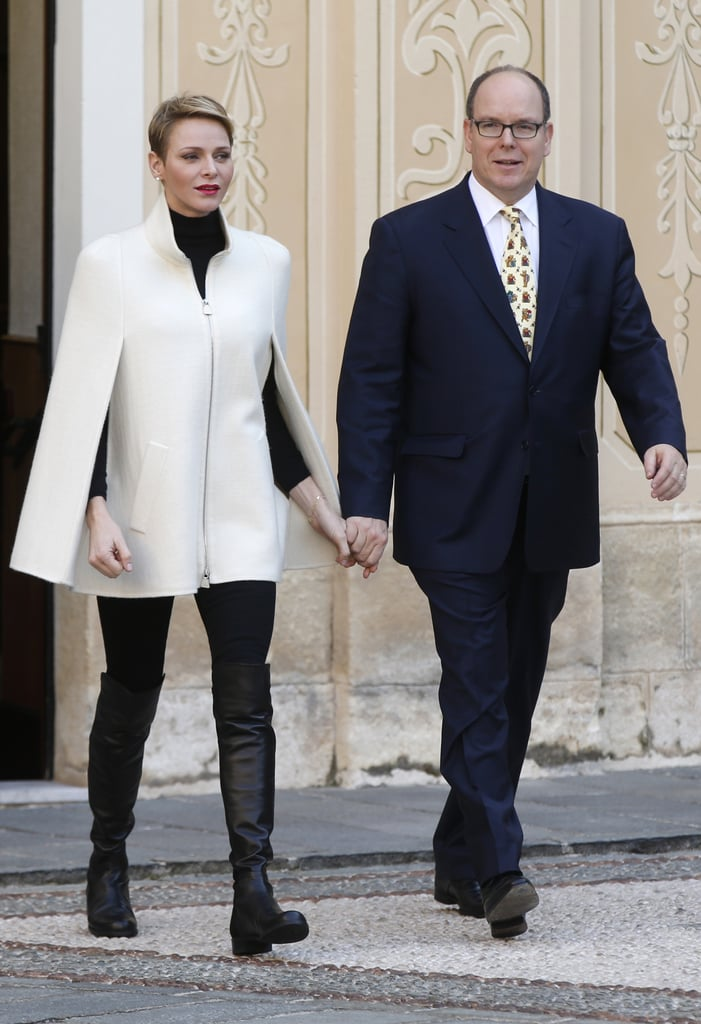 For an official outing with her husband, Prince Albert II of Monaco, Princess Charlene wore a black sweater, black pants, black over-the-knee boots, and a cream cape coat.