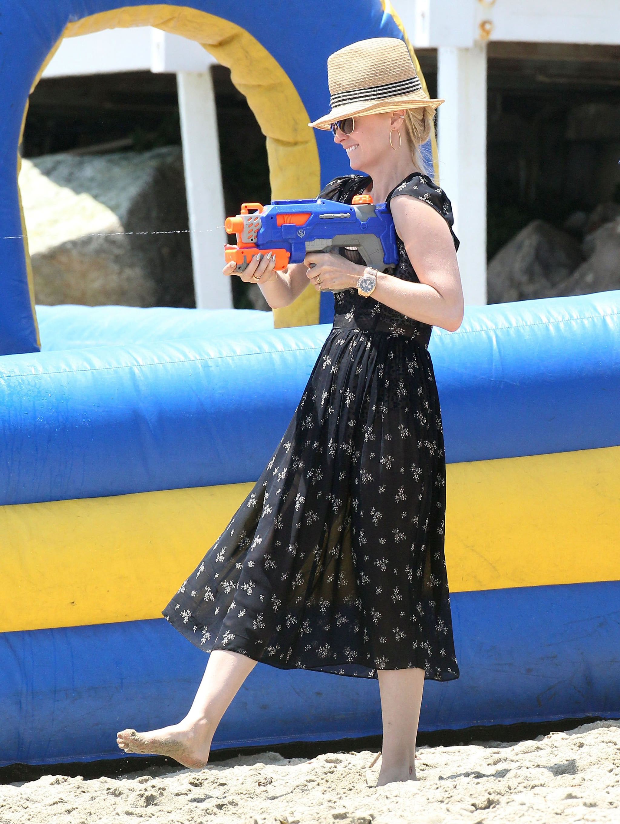 January Jones played with a squirt gun.