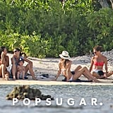 Miranda Kerr relaxed in the sand with husband Orlando Bloom and baby Flynn in Bora Bora.