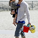 Joel Madden carried Sparrow along with some beach pails during a family trip to Malibu for Easter.