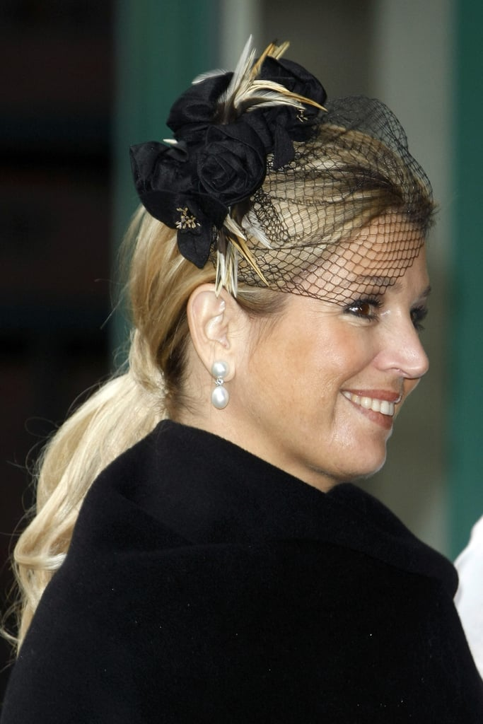 Princess Maxima of the Netherlands visited Germany wearing a sexy fascinator that featured roses and fishnet.