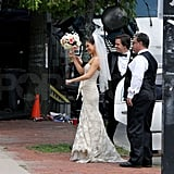 Mila Kunis prepared to throw her bouquet.